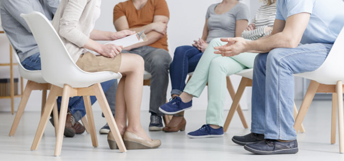 Group of people in a circle - Addiction Services