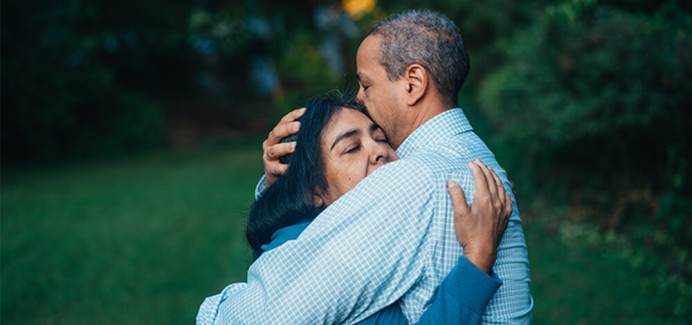 Man Hugging Woman - Crisis Intervention Services