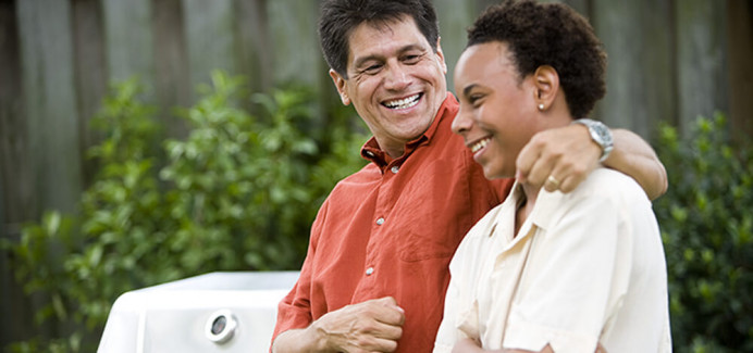Man sitting with young man - Foster Care Services