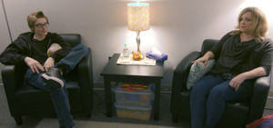 Woman and Boy talking in counseling office - Autism Spectrum Services